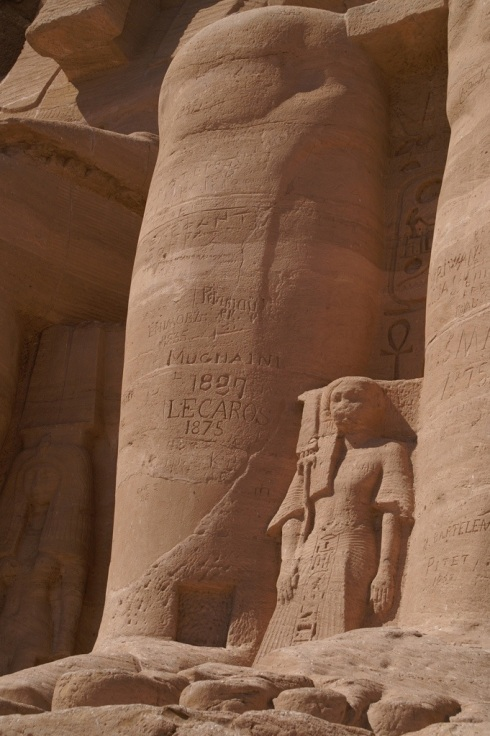 Leg of Rameses II at Abu Simbel close up, the 19th century graffiti betraying the lack of European respect for ancient sculpture